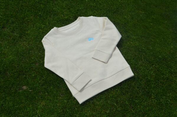 Sweater Vlasbloem